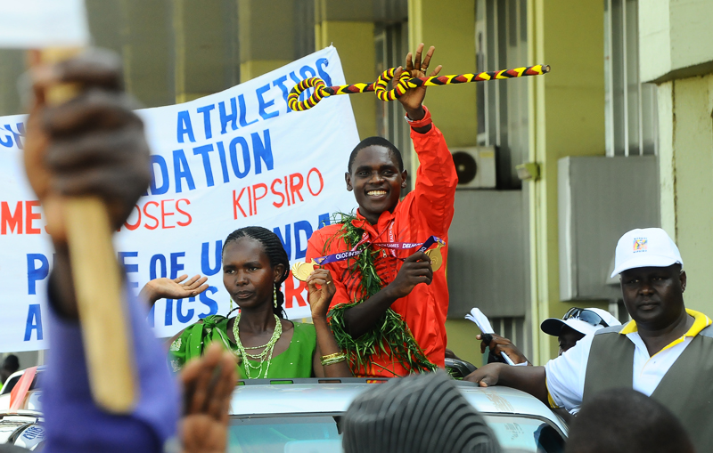 Kipsiro and Wife wave to the crowd at Entebbe Airport