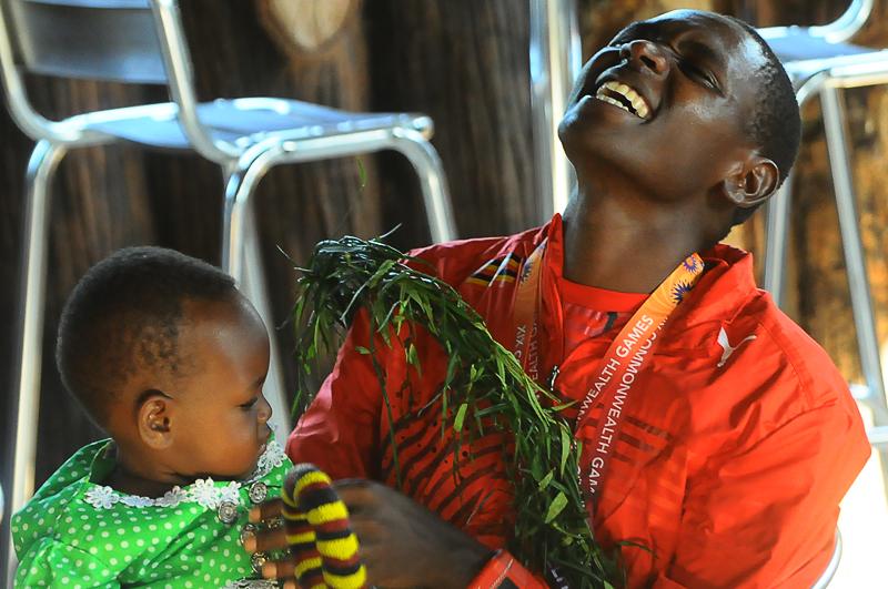 Kipsiro holds his baby in disbelief