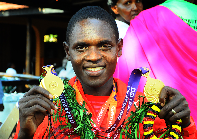 Kipsiro shows his 5000 and 10000mm gold medals