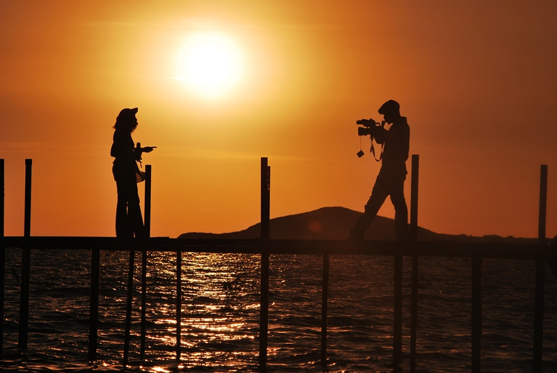 "This is one of my all time best sunset shots. Its an NBS TV crew shooting a valentines day trip for couples to Bulago Islands for the ""Pandona Magazine"" program"