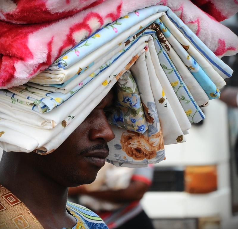 A hawker listens to Kiiza Besigye at Nkumba