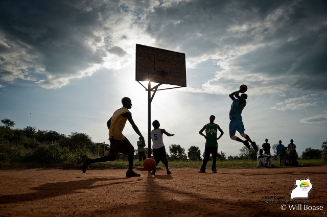 Young Acholi men play basketball in the late afternoon in Kitgum town. The town was repeatedly attacked during the war, but life is beginning to return to normal.