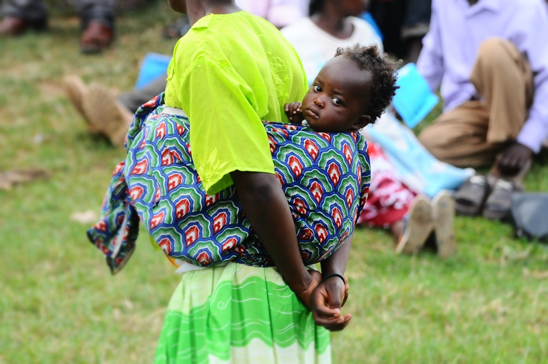 A mother attends a Besigye rally in Lukaya town