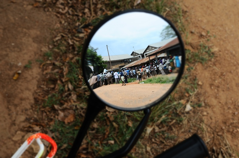 A reflection of Kiiza Besigye campaigning in a village in Kalungu district