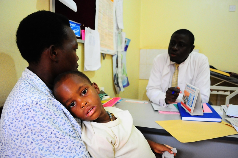 An HIV/AIDS positive child wears a helpless face at Mengo hospital
