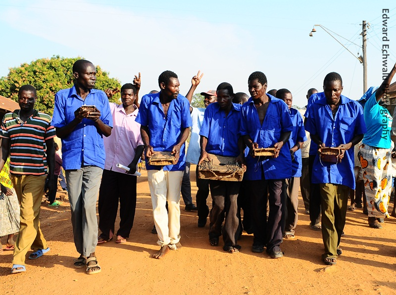"Men play ""Akongo"", a traditional music instrument for the Teso people in Serere district"