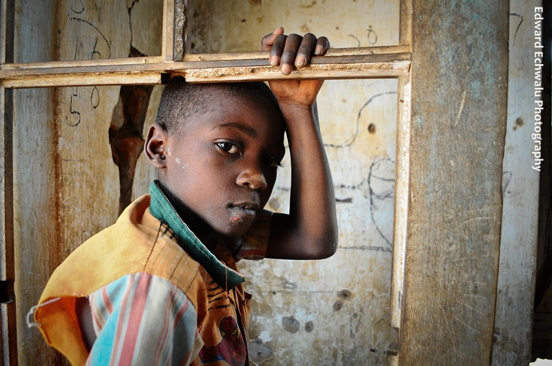 Is there a future for me? A boy plays in a dilapidated classroom in Ngora town council