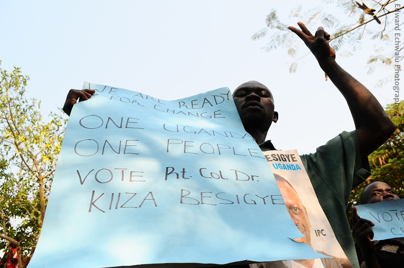 Issues: A supporter holds a placard written on with demands that the people of Pawor in Obongi subcounty, Arua would want to change once Kizza Besigye takes over power