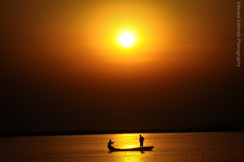 Fishermen are silhouetted on River Nile on January 24, 2011