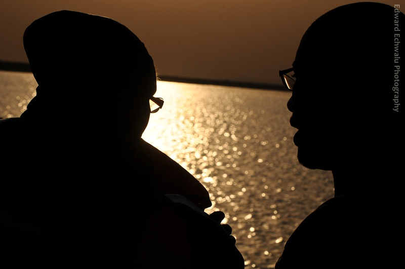 (L-R) Winnie Byanyima, wife to Presidential candiate, Kizza Besigye is being interviewed by The Observer journalist Edris Kiggundu while crossing the Nile into Moyo on a ferry on January 24, 2011