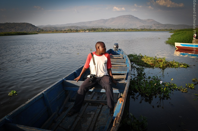 New Vision Photojournalist, Godfrey Kimono waiting for a ride in a canoe on January 24, 2011 in Adjumani
