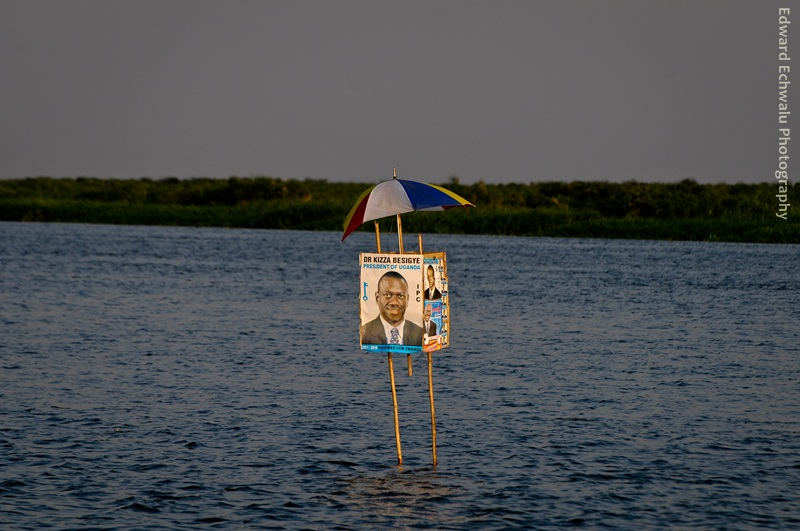 Posters of Kizza Besigye are seen in the middle of River Nile in between Adjumani and Moyo districts on January 24, 2011