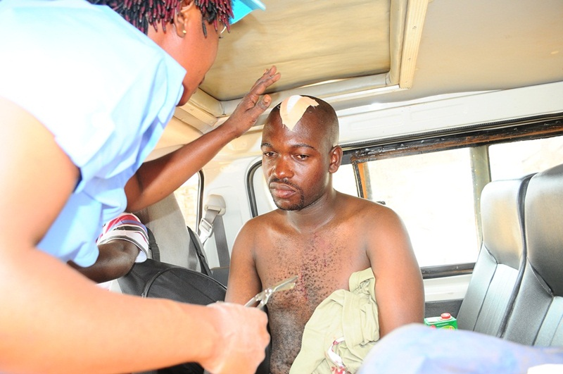 Michael Kakumirizi,a photojournalist with Red Pepper gets dressed up after sustaining a cut on the head when a fight broke between FDC and NRM supporters in Aloi Subcounty, Aleptong district.