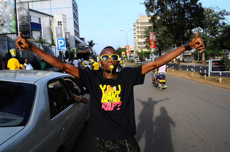 Museveni supporters march through the streets of Kampala moments after Museveni was announced the winner of the presidential elections with 68% as opposed to Kizza Besigye's 26%