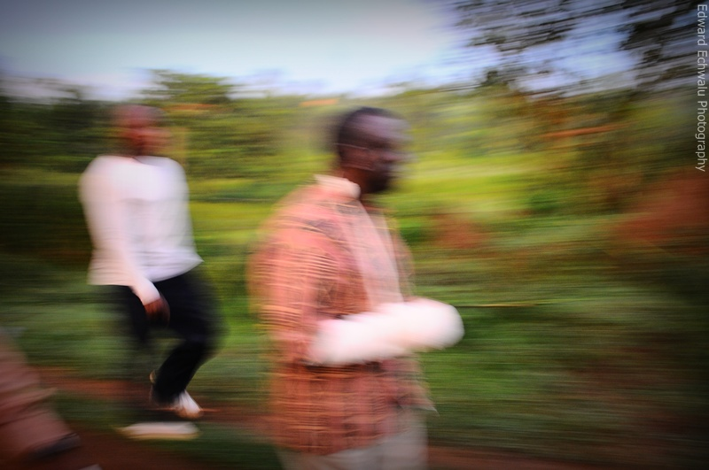 Kizza Besigye walks to walk shortly before being arrested by security men on April 18, 2011