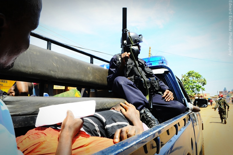Military Police arrest a protester in Kireka during on April 18, 2011