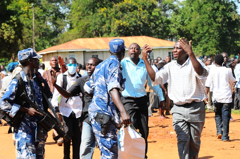 Some of the protestors complain to police of the treatment of Kizza Besigye in Kasangati
