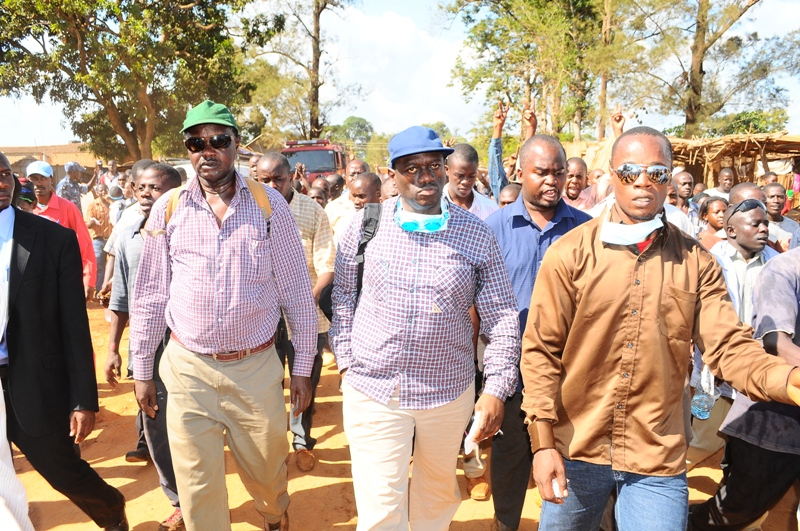 Free At Last: Kizza Besigye (centre)  is escorted through Kasangati centre to his home after being released on bail