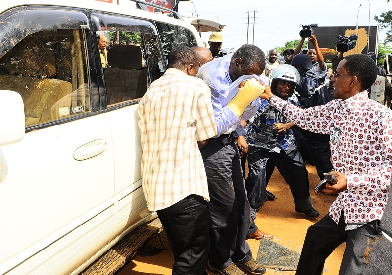 Too much Pepper Spray rendered Kizza Besigye and some of his supporter helpless before being arrested on April 28, 2011