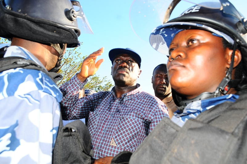 """Opposition leader for Forum for Democratic Change, Kizza Besigye is intercepted at Kitetika on his way to office by Anti-Riot Police, accusing him of """"walking to work"""""""