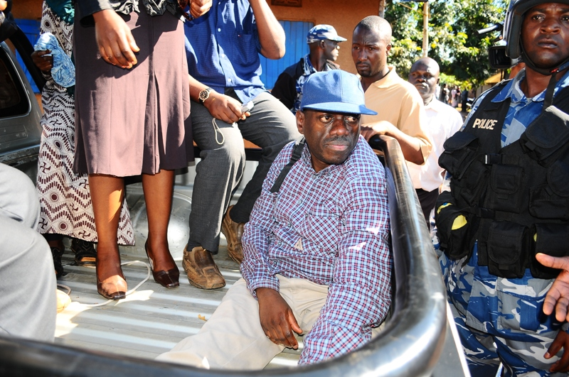 Opposition leader, Kizza Besigye is arrested and is seen here seated at the back of a police pick up after being arrested for allegedly inciting the public according to police