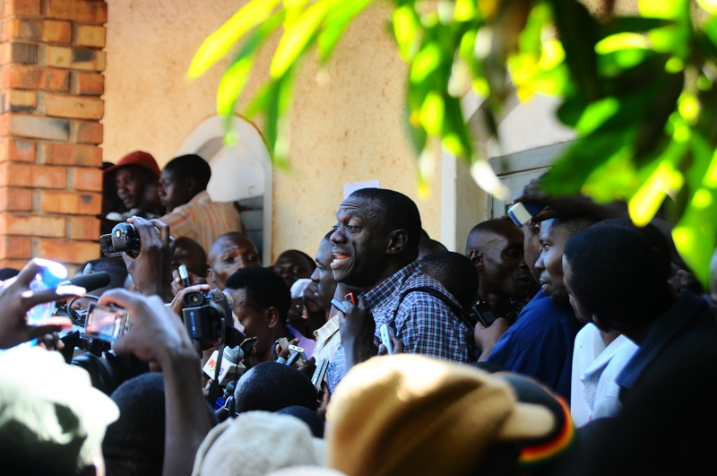 Kizza Besigye addresses the crowd outside court after being released on bail
