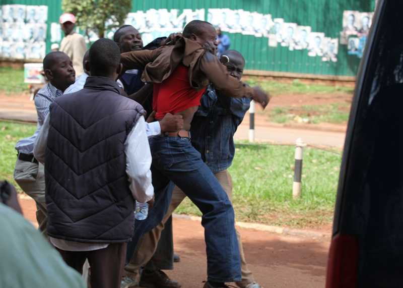 One of the men who did everything to protect Kizza Besigye is arrested after being sprayed with cans and cans of teargas/Pepper spray