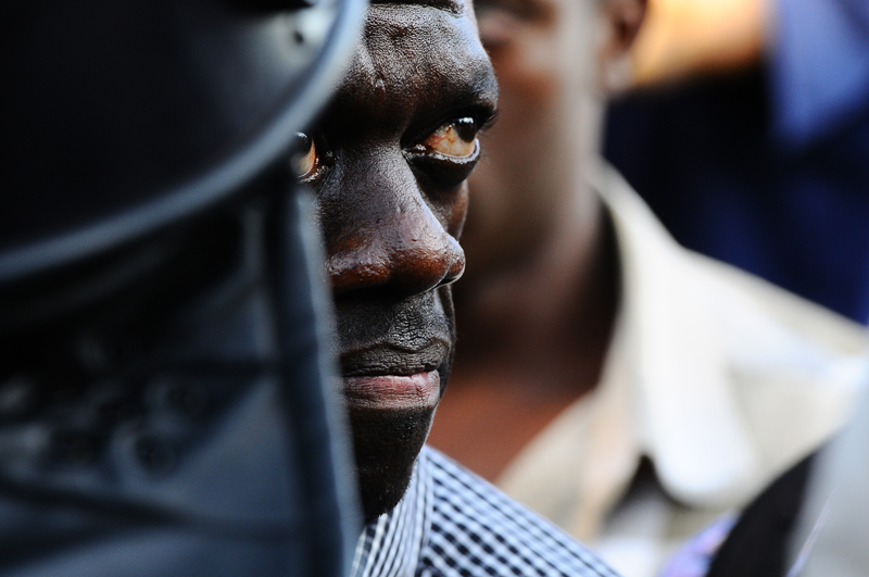 Uganda's Forum for Democratic Change (FDC) leader Kizza Besigye is arrested by anti-riot policemen at the Kasangati suburb of the capital Kampala yesterday