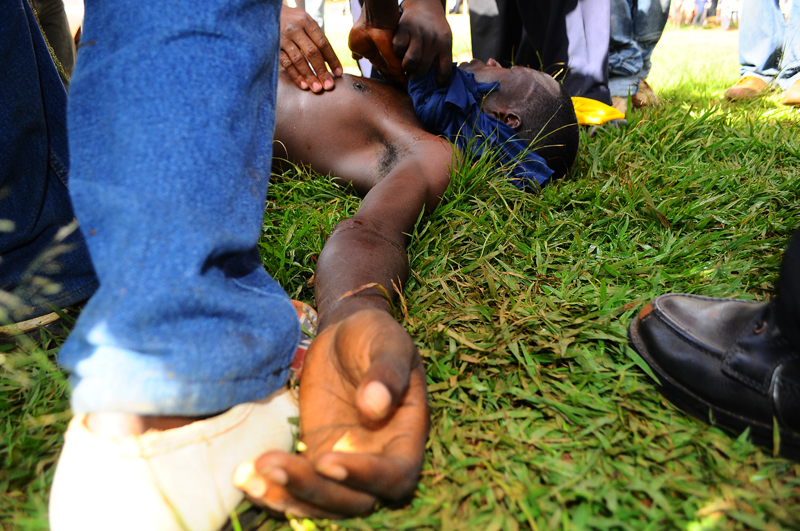 A protester injured by a teargas canister during the walk to work protest in Kasangati suburb of the capital, Kampala by opposition leader for Forum for Democratic Change (FDC), Kizza Besigye on April 15, 2011