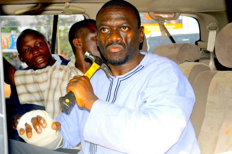 Can you spot the difference between these two hammers? Kizza Besigye is seen with the hammer he allegedly was hiding in the car according to Kirunda Kiveijinja