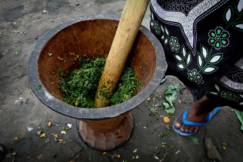 Greens pounded for cooking in a Dar es salaam suburb