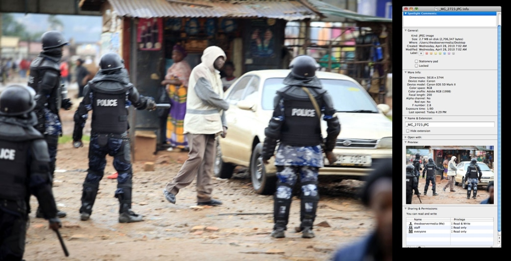 I took this hazy picture of the hooded hammer man in Kubiri where Besigye was first stopped from driving to the bank. Here, Police thought he was just an ordinary curious man and tried to send him away from the scene.