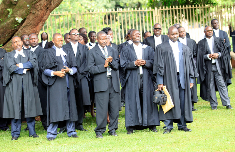Lawyers listen to Chief Justice Benjamin Odoki's address at the High Court