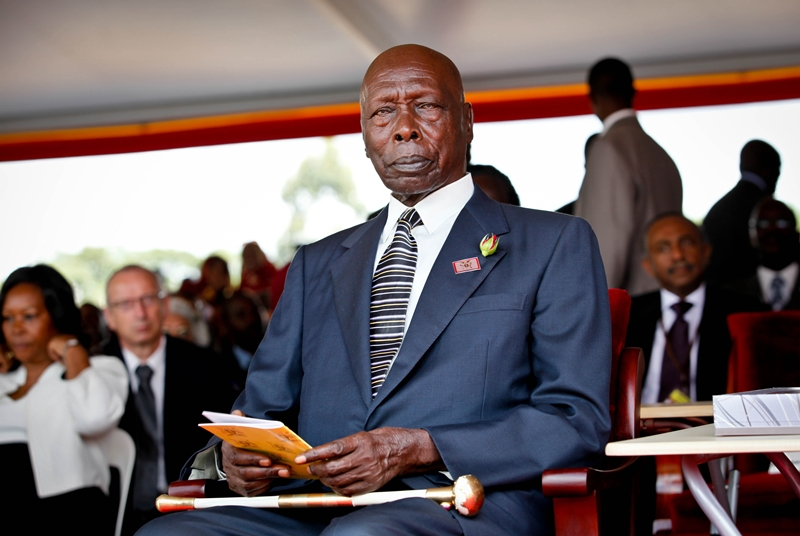 Former Kenyan president, Daniel Arap Moi poses for the cameras moments after taking his seat on arrival for the swearing in ceremony of President Yoweri Museveni at Kololo Airstrip on May 12, 2011