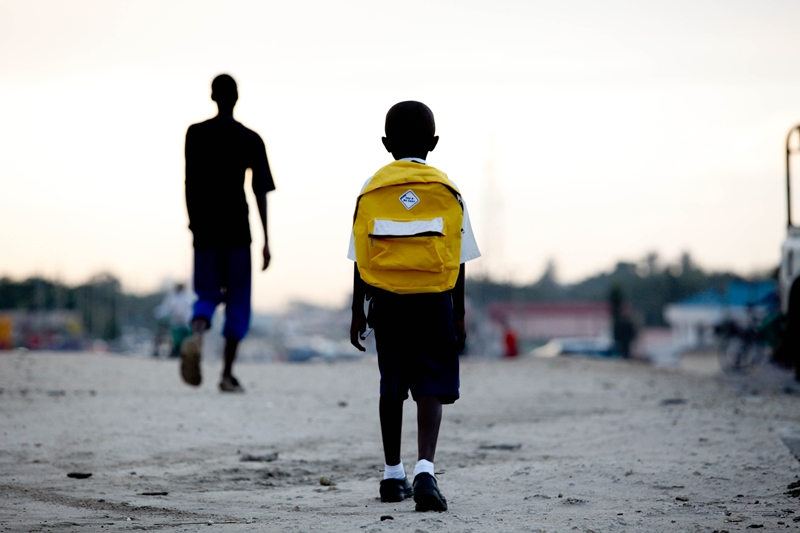 School boy walks back home in Mtoni, Dar es salaam
