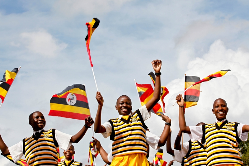 School children perform before guests at the swearing in ceremony of President Yoweri Museveni at Kololo Airstrip on May 12, 2011
