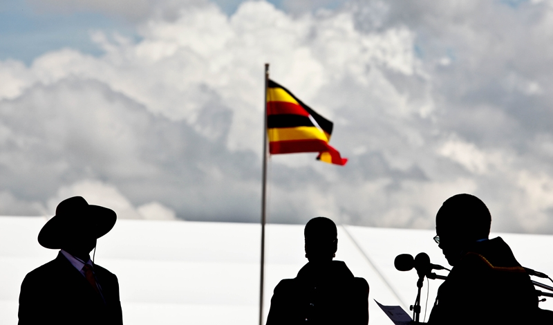 President Museveni us silhouetted at the podium as he took got ready to take his oath at Kololo Airstrip on May12, 2011