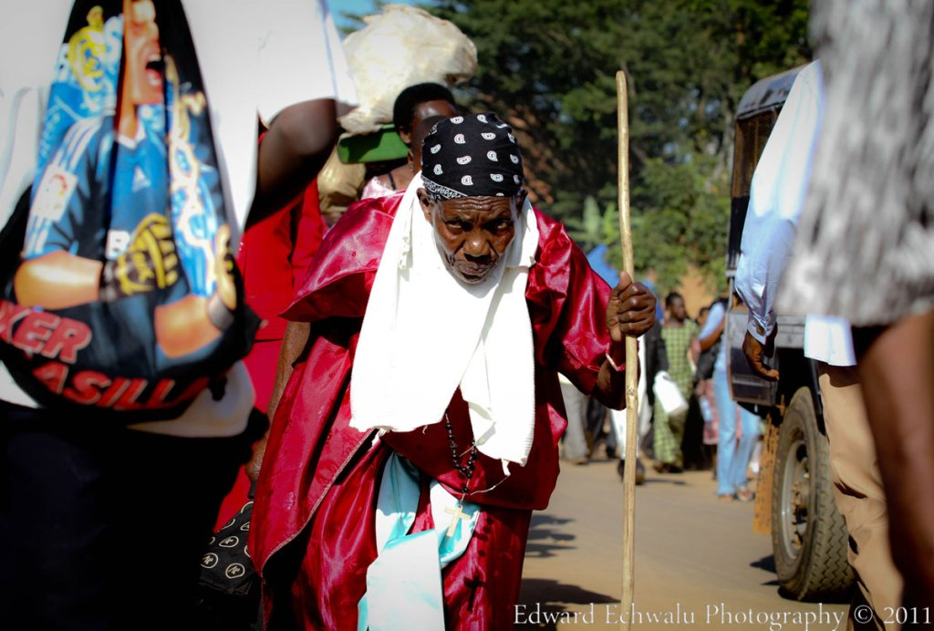 An elderly pilgrim walks to the Namugongo Shrine to attend prayers during the Martyrs day celebrations on June 3, 2011. The Uganda Martyrs were Christian converts who were murdered for their faith