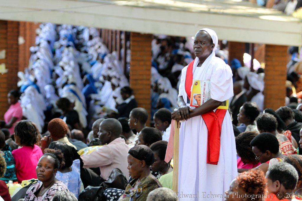 An Usher monitors pilgrims during the Martyrs Day celebrations at Namugongo Shrine on June 3, 2011. The Uganda Martyrs were Christian converts who were murdered for their faith. The Namugongo Shrine thousands of Pilgrims from all over the world. South Africa, DR Congo, Rwanda, USA, Germany, Kenya, Tanzania, Southern Sudan, Burundi, Nigeria were among the countries that sent pilgrims.