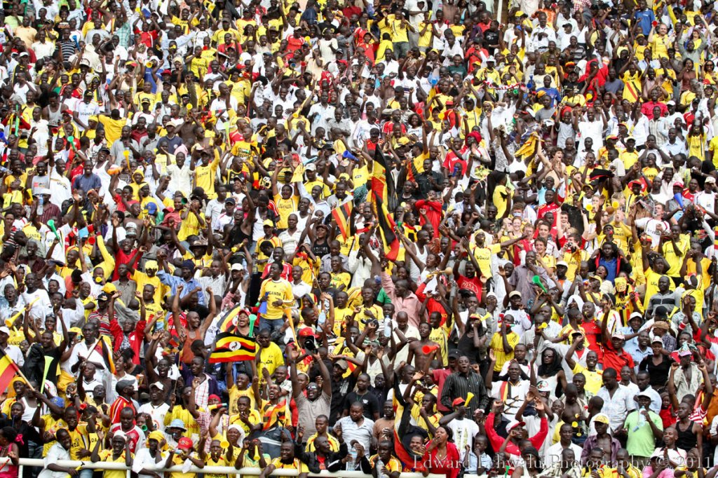 An estimated crowd of over 60.000 Uganda fans celebrate the second goal scored by Geoffrey Massa at the Mandela Nation Stadium (Namboole). The Uganda Cranes won the match 2-0. With 10 points gathered so far, it literally means Uganda needs a point in their two remaining fixtures against Angola (September 3) and Kenya (October 8) to qualify for the finals for the first time since 1978