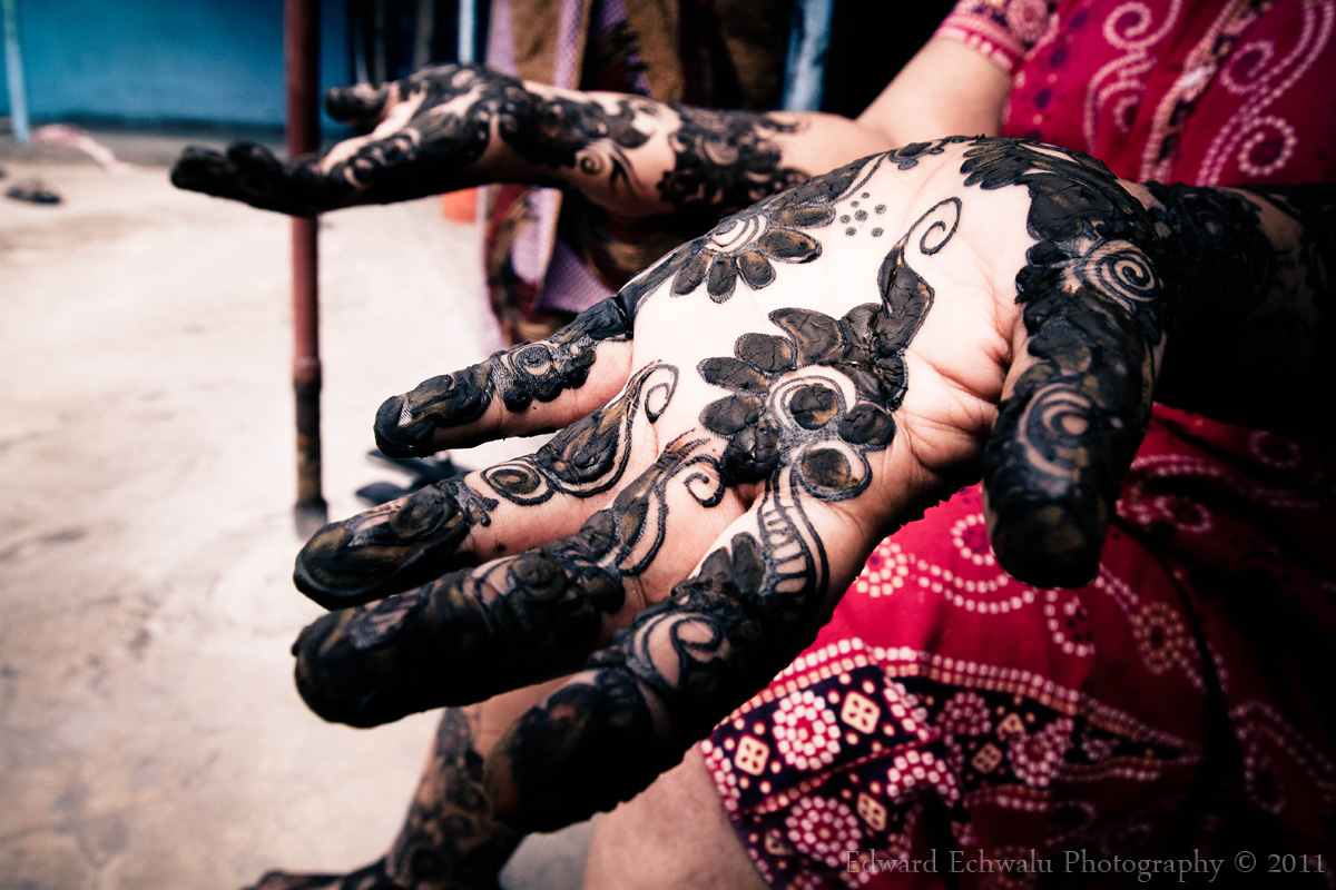 A woman displays henna designs