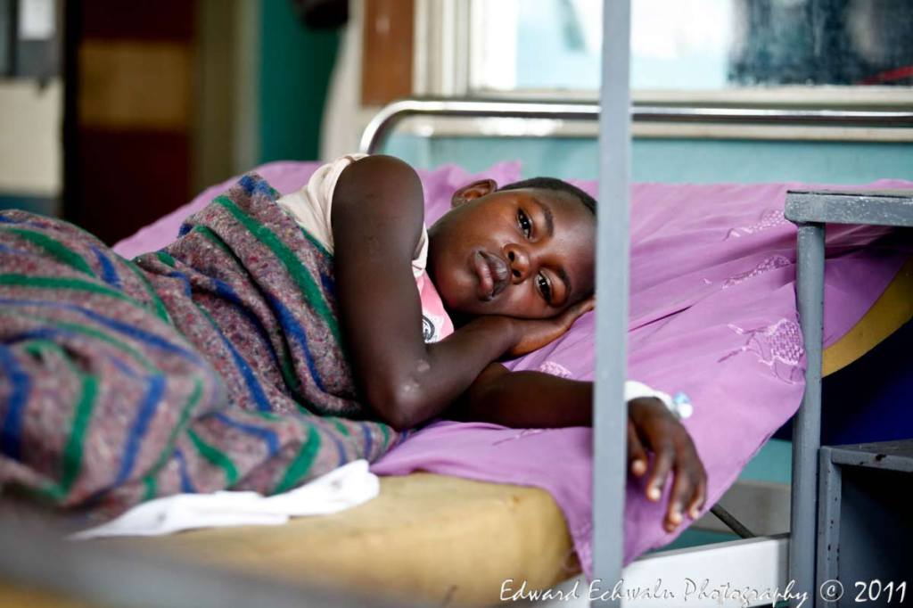 A pupil, who survived after lightning struck their classroom, receives treatment at Kiryandongo hospital, 210 km (130 miles) north of Uganda's capital Kampala, June 29, 2011. The lightning strike killed 18 children and their teacher. Uganda has one of the highest rates of lightning strike deaths in the world and its capital Kampala has more days of lightning per year than any other city, according to the World Meteorological Organization.