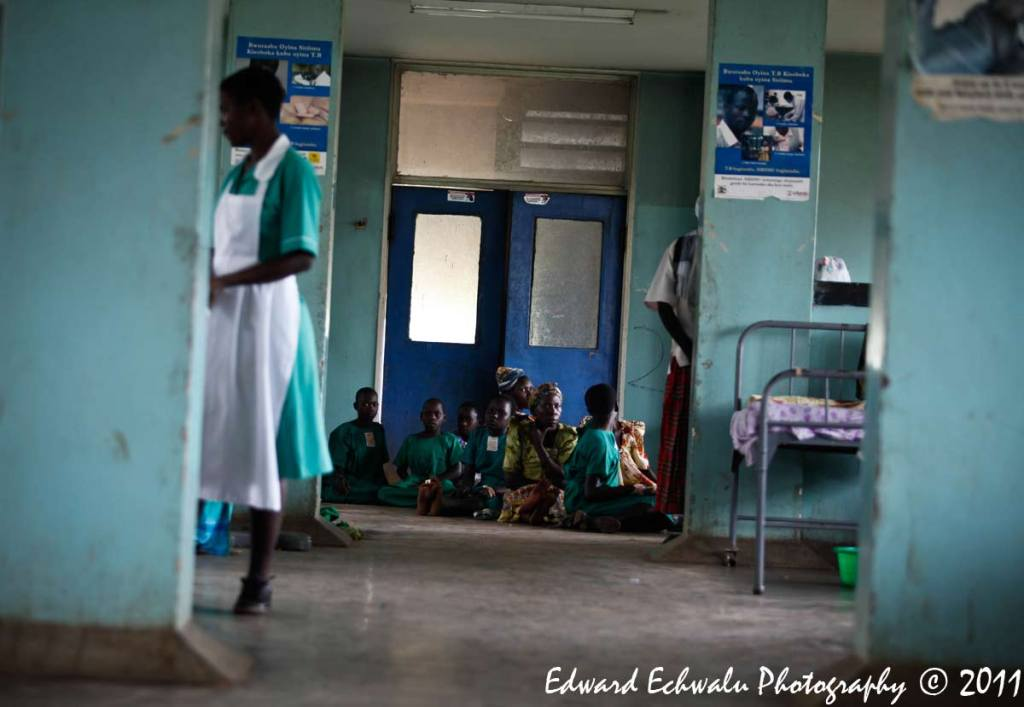 Schoolchildren who survived after lightning struck their classroom wait to receive treatment at Kiryandongo hospital, 210 km (130 miles) north of Uganda's capital Kampala, June 29, 2011. A lightning strike has killed 18 children and their teacher in Uganda, police said. Uganda has one of the highest rates of lightning strike deaths in the world and its capital Kampala has more days of lightning per year than any other city, according to the World Meteorological Organization.