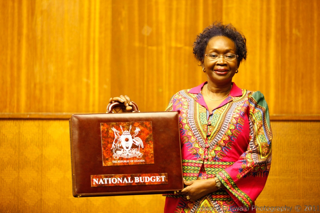 Uganda's finance Minister, Maria Kiwanuka arrives with a suitcase containing the Uganda budget 2011/2012 at the Serena Hotel Kampala where Parliament had convened on June 8, 2011. Uganda's Finance Ministry cut its growth forecast for the 2010-11 fiscal year to 6.3 percent following a slump in the production of cash crops because of poor rains.