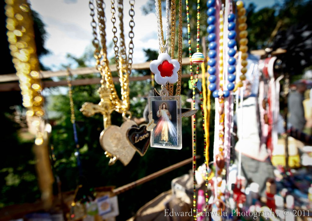 "A necklace bearing a picture of ""Jesus"" is sold near Namugongo shrine during the martyrs day celebrations on June 3, 2011"