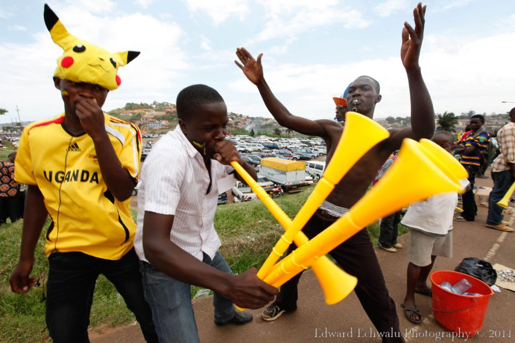 Blow and Sell: Fans sell Vuvuzelas a few hours before kick-off. Thousands of Vuvuzela made their way into Mandela Nation Stadium (Namboole) where the Uganda Cranes humbled Guinea Bissau 2-0. With 10 points gathered so far, it literally means Uganda needs a point in their two remaining fixtures against Angola (September 3) and Kenya (October 8) to qualify for the finals for the first time since 1978.