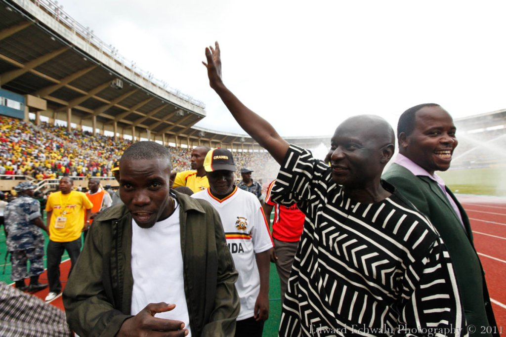 Political Fortune:  Olara Otunnu waves to the crowds after Cranes beat Guinea Bissau 2-0 with goals from Godfrey Walusimbi and Geoffrey Massa. . With 10 points gathered so far, it literally means Uganda needs a point in their two remaining fixtures against Angola (September 3) and Kenya (October 8) to qualify for the finals for the first time since 1978