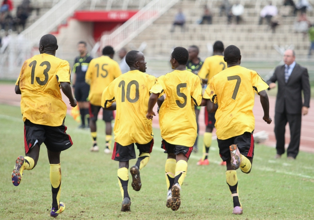 ( L-R )Uganda's Moses Oloya,Hamis 'Diego' Kiiza, Mike Mutyaba, Emma Okwi celebrate one of five goals they scored against Kenya at the Nyayo National Stadium in Nairobi on June 27, 2011.The game was postponed from yesterday by match commissioner Maxwell Mtonga from Malawi  even before the centre referee could blow his whistle at Nyayo National Stadium, when heavens opened up and the downpour never ceased.Uganda had in the previous round beaten Tanzania 5-2 on aggregate
