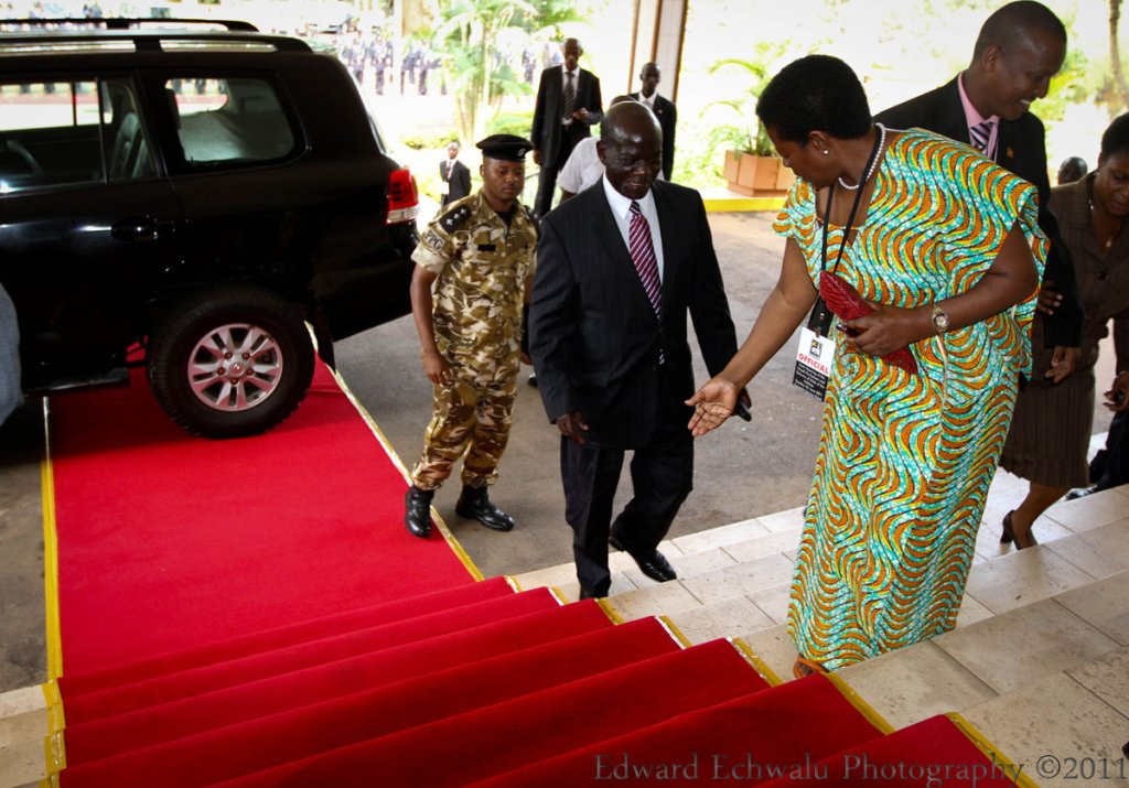 "Your Excellency, you can walk on the carpet please."" Chief of Protocol tells Ssekandi. 'Oh?' He smiles back probably with some degree of embarrassment."