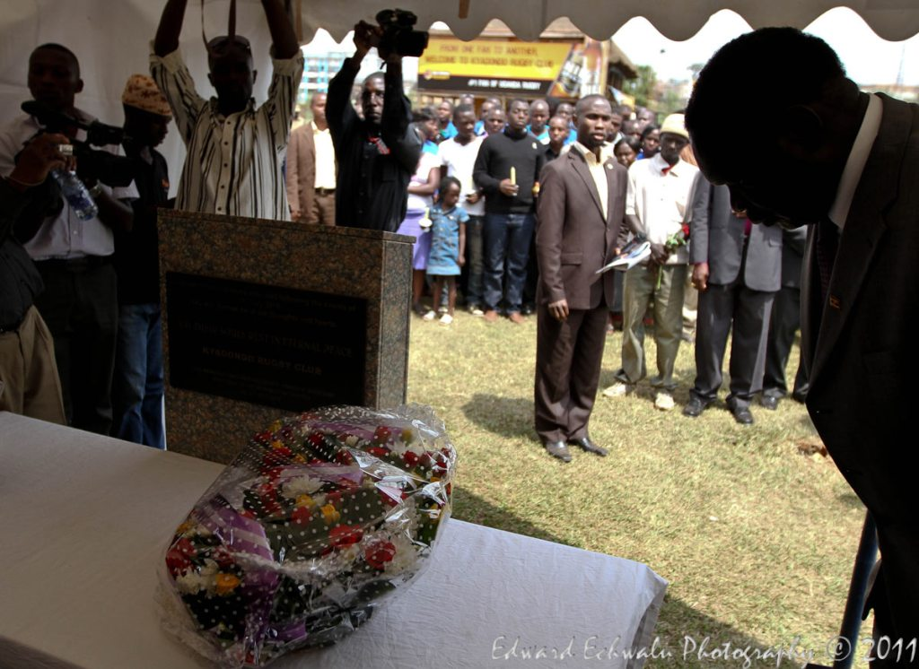 Internal Affairs Minister Hilary Onek pays his respect after laying the wrath on the memorial slab at the Kyadondo Rugby Club on July 11, 2011. In total, 86 people were killed in a twin bomb blast on July 11, 2010 while watching the football world cup finals in Kampala.